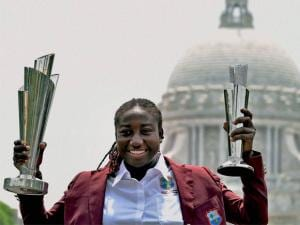 West Indies Women Captain Stafanie Taylor holds ICC T20 World Cup and Women of the Tournament Trophy in front of Victoria Memorial in Kolkata
