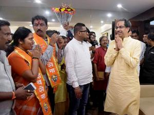 Shiv Sena President Uddhav Thackeray being greeted by winning candidates as he arrives to address a press conference