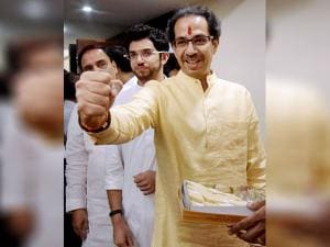Shiv Sena President Uddhav Thackeray gestures as he arrives to address a press conference