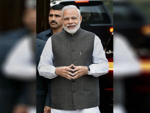 Narendra Modi arrives for the opening day of the winter session of Parliament