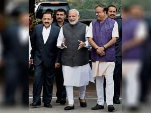 Narendra Modi arrives with  his cabinet colleagues for the opening day of the winter session of Parliament