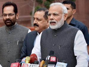 Narendra Modi talking to the media during the opening day of the winter session of parliament