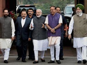 Prime Minister Narendra Modi with  his cabinet colleagues as he arrives for the opening day of the winter session of Parliament