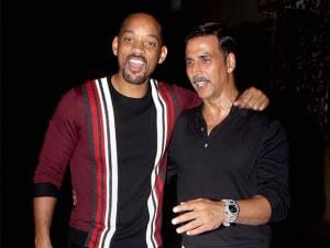 Akshay Kumar with  Will Smith during a party