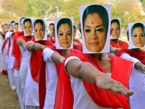 Students of Maulana Azad Muslim Mahila B.Ed College wearing the mask of Rajasthan Chief Minister Vasundhara Raje as they take the oath to become a 'Strong and Successful Women' on the occasion of her