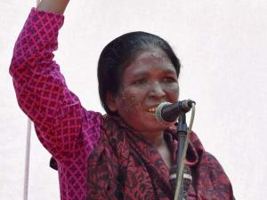 Tribal activist and Aam Aadmi Party (AAP) leader Soni Sori addresses a demonstration organised by the members of All India Progressive Women's Association (AIPWA) to mark International Women's Day at