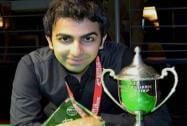 Pankaj Advani poses for photographs after winning the World Billiards Championship (time format) in Leeds