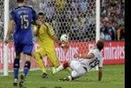 Germany's Mario Goetze scores the opening goal past Argentina's goalkeeper