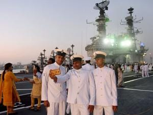 Naval officers take a selfie after the decommissioning ceremony of INS Viraat at naval dockyard in Mumbai