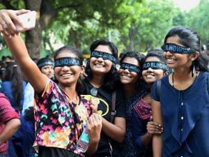 People taking selfie during 'blind walk' at an event organised to mark World Sight Day