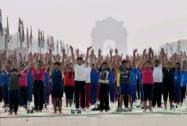 School children participate in a full dress rehearsal for International Yoga Day at Rajpath