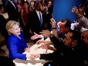 Democratic presidential candidate Hillary Clinton greets employees at the Mirage in Las Vegas