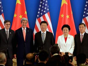 China's President  Xi Jinping with U.S. Secretary of State John Kerry during the Joint Opening Ceremony of the 8th U.S.-China Strategic Dialogues