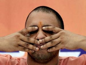 Yogi Adityanath participates in a yoga practice session in Lucknow