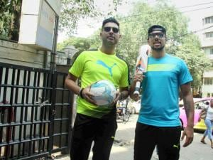 Cricketer Yuvraj Singh and Robin Singh at a promotional event at Khar in Mumbai