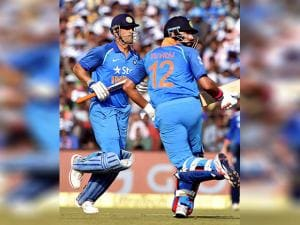 India's M S Dhoni and Yuvraj Singh cross for runs during the 2nd ODI Match against England
