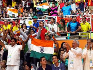 Supporters of India holding tricolor during a women's singles final match