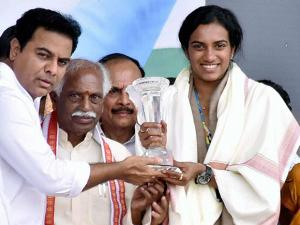 PV Sindhu being felicitated by K.T.Rama Rao