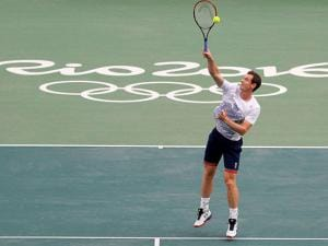 Andy Murray, of Britain, returns a ball during a practice session