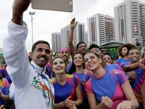 Indian coach Muhammad Kunhi takes a selfie with performers