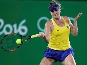 Elina Svitolina, of Ukraine, returns to Serena Williams, of the United States