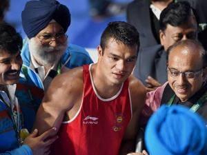 Union Sport Minister Vijay Goyal congratulating Indian Boxer Vikas Krishan Yadav after his victory