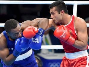 Vikas Krishan fights Charles Albert Shone Conwell of USA in Preliminaries Men's Middle (75Kg)