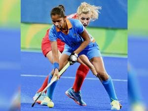 India's Navjot fight for ball with the Great Britain player during the Hockey