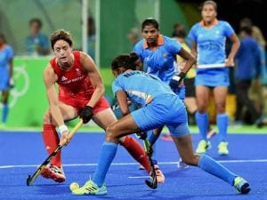 Women Hockey players vie for the ball during their match at Rio Olympics 2016