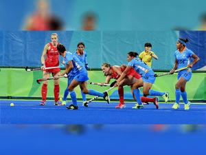 Women Hockey players vie for the ball during their match at Rio Olympics 2016 at Rio de Janeiro