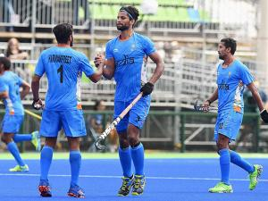 India's Rupinder and Harmanpreet Singh celebrate after a goal against Germany at Rio Olympics 2016