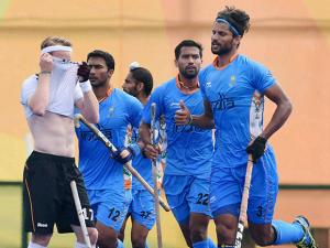 India's Rupinder celebrates after a goal against Germany at Rio Olympics 2016