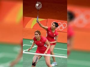 Jwala Gutta  and Ashwini Ponnappa play Women Double against Japan