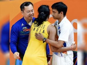 PV Sindhu celebrate with her coach Gopichand after defeating Japan's Nozomi Okuhara