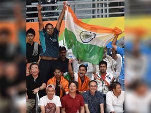 Supporters of India holding tricolor   during a women's singles semifinal match at the 2016 Summer Olympics in Rio de Janeiro