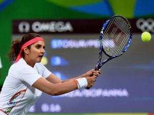 Sania Mirza And Rohan Bopanna  play their mixed doubles match during the 2016 Rio Olympics