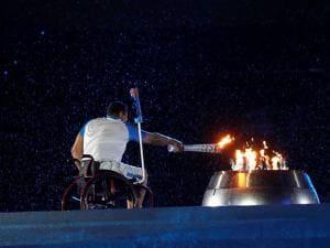 Brazilian athlete Clodoaldo da Silva lights up the cauldron