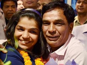 Bronze medalist India's first woman wrestler Sakshi Malik being greeted by her father