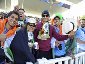 Indian cricket fans cheer for their team before the start of the ICC Champions Trophy match between India and Pakistan