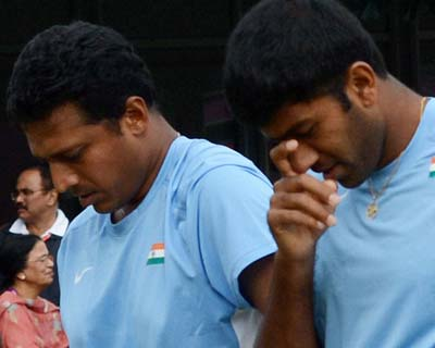 Mahesh Bhupathi and Rohan Bopanna react after losing Tuesday's match