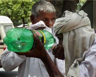 Activist of  Bhartiya Kisan Union drinking water