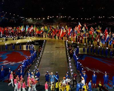 Competing Nations parade flags at the Olympic stadium during the closing ceremony
