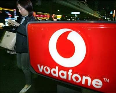 Vodafone cuts revenue outlook on European woes