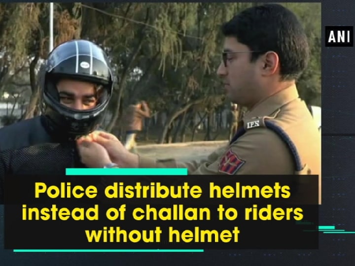 Police distribute helmets instead of challan to riders without helmet