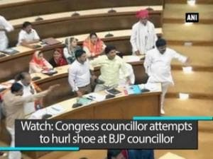 Watch: Congress councillor attempts to hurl shoe at BJP councillor