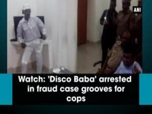 Watch: 'Disco Baba' arrested in fraud case grooves for cops