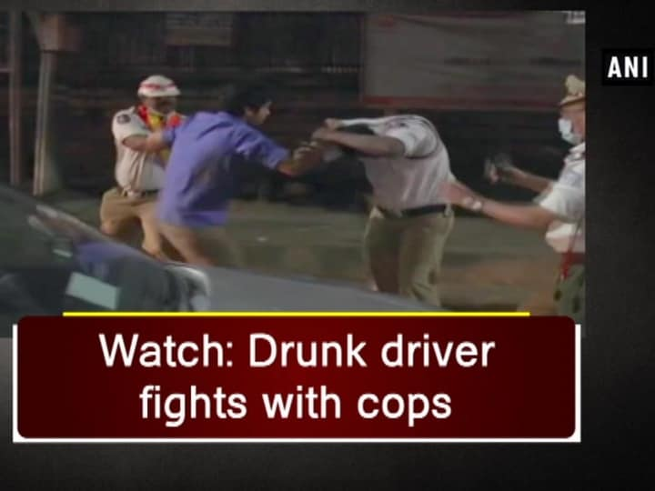 Watch: Drunk driver fights with cops