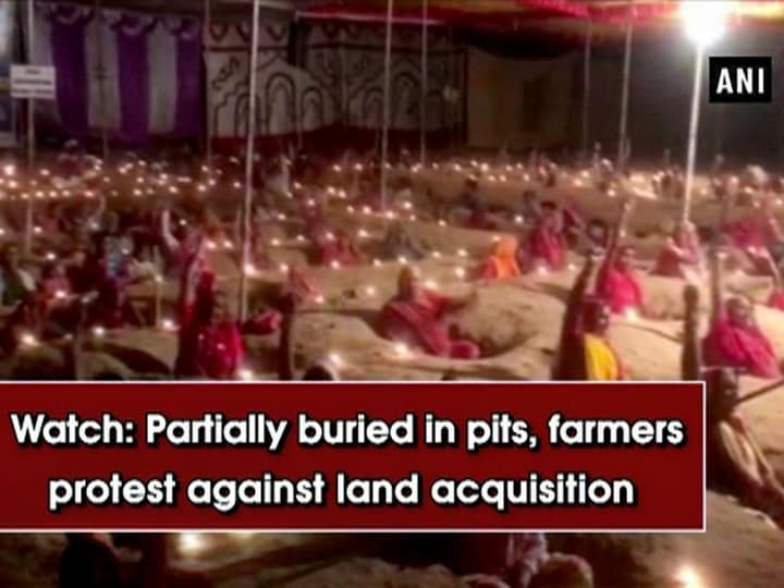 Watch: Partially buried in pits, farmers protest against land acquisition