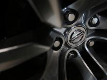 A logo of Nissan Motor Co