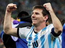 Sao Paulo : Argentina's Lionel Messi pumps his fists after Argentina defeated the Netherlands at the Itaquerao Stadium in Sao Paulo Brazil